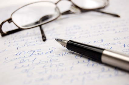 Image of pen and glasses.