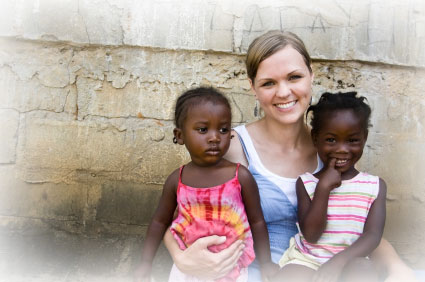 Photo of NGO volunteer with 2 girls.