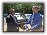 Photo of Gen Boroh shaking hands with Dr. Harvey Langholtz.
