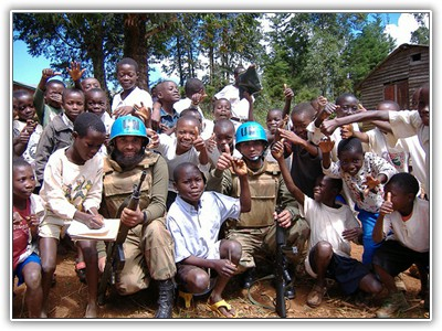 Photo of peacekeepers with children in the Congo - submitted by a POTI student.